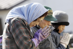 Survivors pray for victims at the devastated city of Miyako, northeastern Japan - (from newsobserver.com)