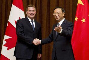 John Baird in China with his counterpart, Yang Jiechi, July 2011. (Andy Wong, AP).