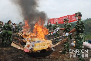 Security personnel burn drugs seized in raids near the China-Myanmar border in Yunnan Province. (Source: Irrawaddy, 2012)