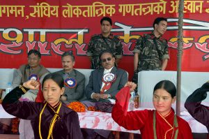 Prachanda (centre) and Bhattarai (centre left), former leaders of the Maoist guerrilla movement, at a rally before they became prime minister and finance minister respectively in 2008 following the King's abdication, photographed before an interview with the authors.