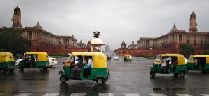 "Auto-rickshaws, or ""autos"" for short, are a major form of transportation in many cities in India, including New Delhi. Source: http://news.nationalgeographic.com/news/energy/2012/04/120412-delhi-india-auto-rickshaws/"