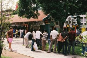 Migrant labourers spending their leisure time in the Little India neighbourhood of Singapore (image source: Wajihah Hamid, 2013).