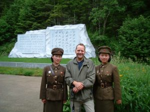 """Nick Bonner with his North Korean guides during the filming of """"A State of Mind"""" (2005)."""