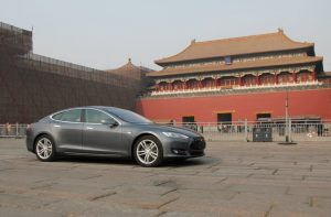 A Tesla electric car in front of Beijing's Forbidden City (Credit: Tesla).