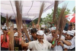 AAP leader and now Chief Minister (Delhi State) Arvind Kejriwal carries his party's telling symbol: the broom (credit: Indo-Asian News Service).