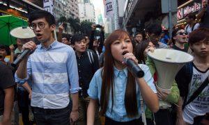 "Sixtus ""Baggio"" Leung and Yau Wai-ching protest Beijing's interpretation of the Hong Kong Basic Law (Credit: Alex Hofford/EPA)."